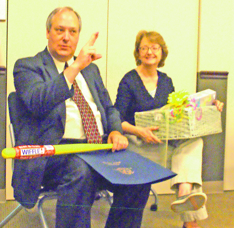 Allyson Kehoe laughs as Dan warns about his plan for the Whiffle bat included in their going-away gifts.