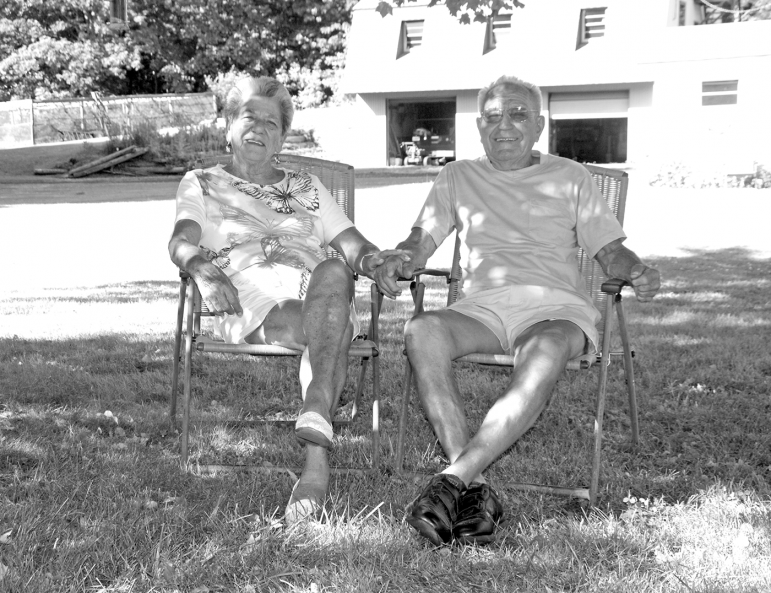 Gloria and Ferman Wilson relax in their neatly kept back yard.