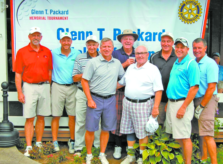 "These gentlemen participated in the original tournament and have played every year for the last 25 years. From the left: Steve Noe, Chris Noe,Dan Sullivan, Dave Sullivan, Warren Packard, ""Mr. C,"" Brian Sullivan, Corey Sullivan and Mark Sullivan."