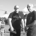 New Deputy Chief Richard Brown, left, and new Superintendent of Police Services Anthony Riello are pictured at the National Night Out, a community-building event originated here by Riello last year. Landing in the background is the helicopter that had been engaged to provide short sightseeing rides during the August 2 event.