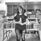 Emily Fabrizi (center), a sophomore at Suffield High School, holds a bottle of shampoo she collected for the Crossroads Food Pantry. With her in Fellowship Hall at the West Suffield Congregational Church are two volunteers from the food pantry, Miriam Blackaby (left) and Mary Calkins.