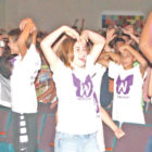 "Enthusiastically dancing along with the speaker, Suffield Middle School students participate in an unusual early-morning assembly program called ""Wingman."""