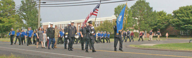 Suffield's short parade for the town's 9/11 Remembrance turns onto Mountain Road at McAlister Intermediate School, heading for the Veterans Memorial.