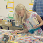 Young Claudia Skoczylas, 9, searches intently for another book to add to her selections. She was one of many customers who came to the Library Friends' sale on Sunday, October 11, when prices were cut in half.