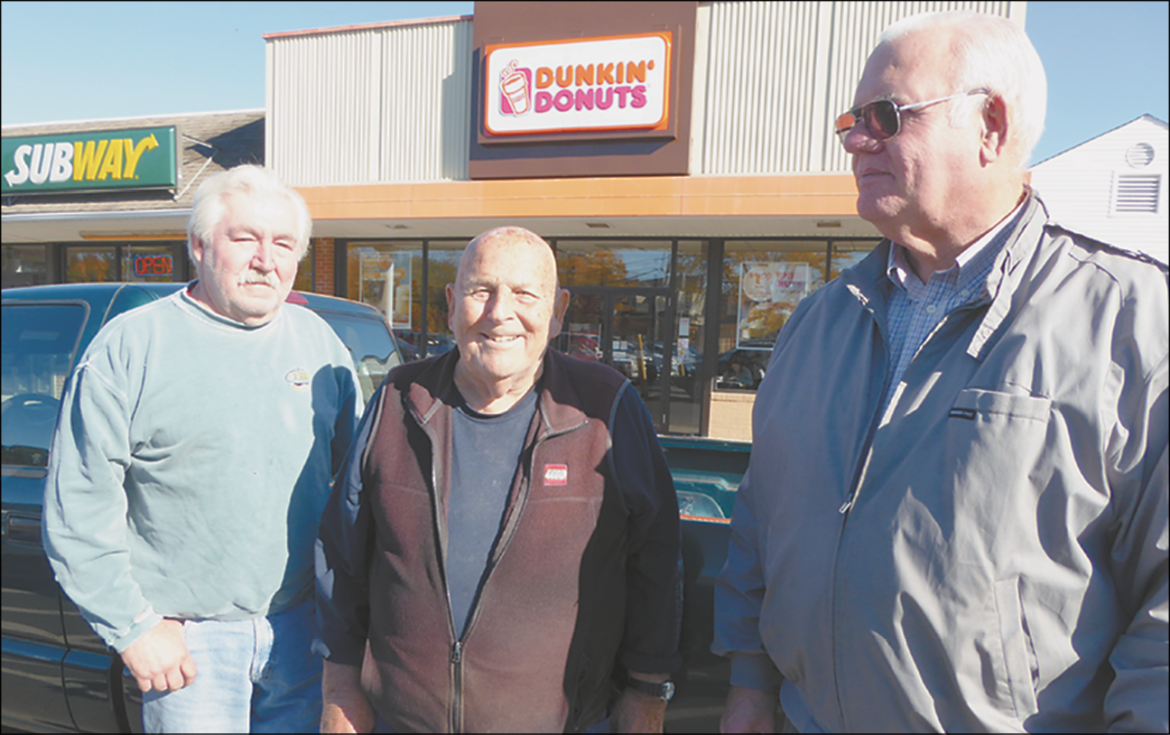 Ed Neilson is pictured with Jeff Ferry (left) and Tom Belmore (right). They are regulars in the Dunkin' Donuts morning discussion group at the former CVS Plaza.
