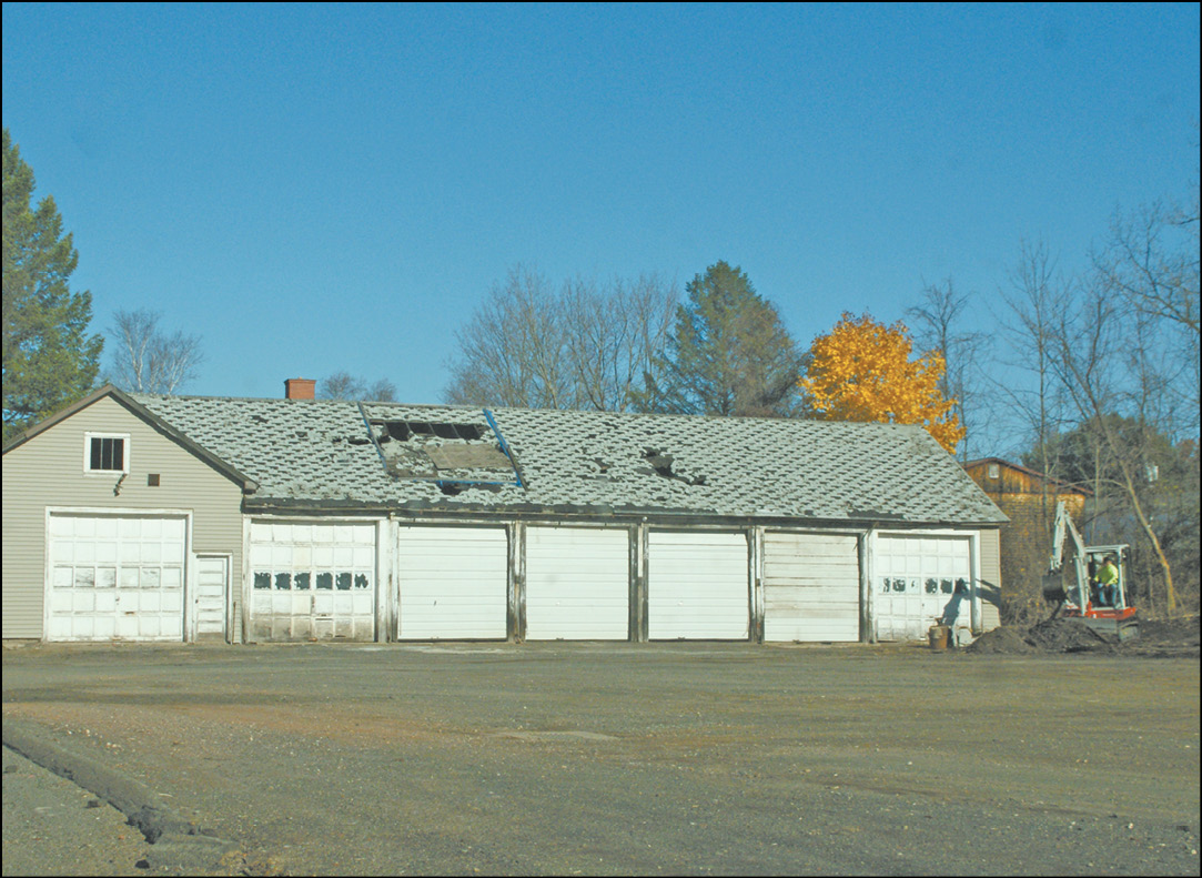 As viewed from Ffyler Place, Suffield's derelict old highway garage is one of three buildings that have been reported to be a discouraging feature for potential developers of the empty space farther down the road. First Selectman Melissa Mack reported in the November 2 Selectmen's meeting that plans were under way for the removal and hazmat remediation of this property. Some clean-up work has already begun.
