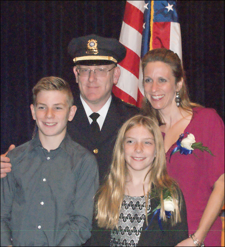 Following his well-attended swearing-in ceremony in the SHS auditorium on November 1, new Suffield Police Chief Richard Brown poses with his family. Clockwise from the Chief: his wife, Julie, daughter Katie, 10, and son Patrick, 12.