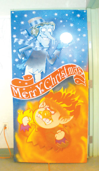 The first prize winner of the Town departments' Christmas door contest is mounted on Highway Department Foreman Mark Cervione's office door. The crew got a free pizza lunch as the award.