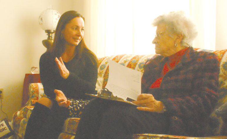 Elle Englander, left, describes her education in Stalinist Poland as she is interviewed by Mary Anne Zak.