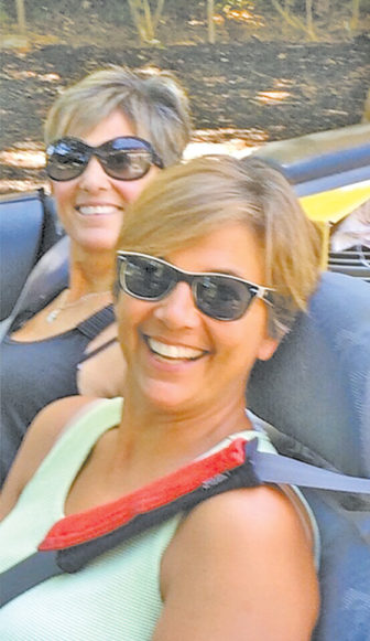 Roz Luongo is pictured at the wheel of her convertible with her sister Annette.