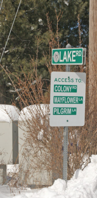 This sign on Copper Hill Road is posted next to mailboxes for the 33 homes accessed via Lake Road.