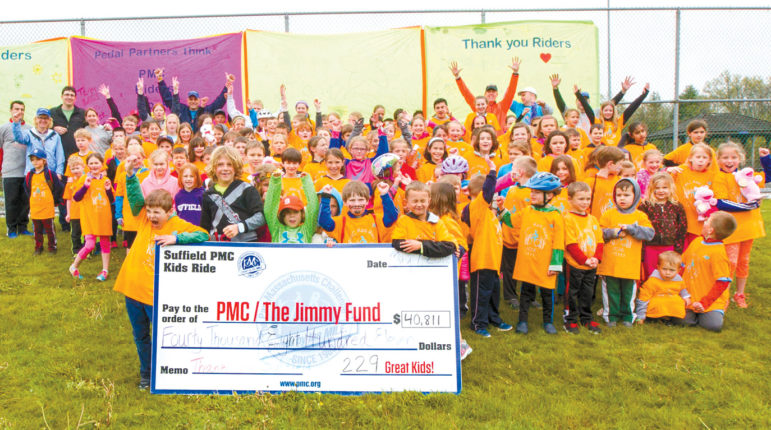 The riders in last year's PMC Kids Ride in Suffield are pictured here with the giant $40,811 check for funds collected.  Let's beat that in 2017!