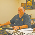 Now honored in the Connecticut Firefighters Hall of Fame, Suffield Fire Chief Chuck Flynn is pictured at his desk in Fire Station Number One.