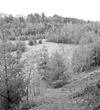 This view of the sand pit property, looking down from Lake Road, shows the previously excavated region where the relocated road will be routed.