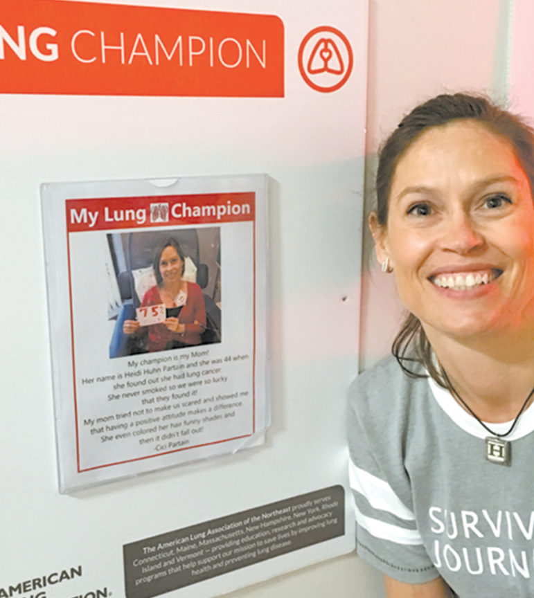 Heidi Huhn Partain is pictured next to the  American Lung Association poster naming her one of their LUNG FORCE HEROES.