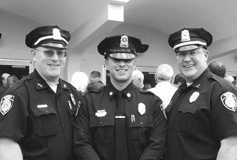 Suffield's new Police Officer Alexander Scata is pictured at his Police Academy graduation ceremony with his new bosses, Chief Richard Brown, left, and Captain Christopher McKee.