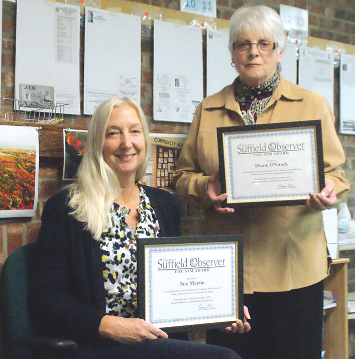 Production crew member Sue Mayne, seated, and Diane O'Grady were unable to attend the volunteers' party; they are pictured at the Observer office with their new Sam Award certificates.