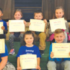 Spaulding students display their kindness certificates at a recent assembly focusing on that quality.