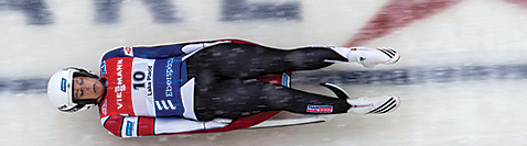 The camera catches slider Emily Sweeney as she flies by, feet first, during the 2014 World Cup luge competition at Lake Placid.