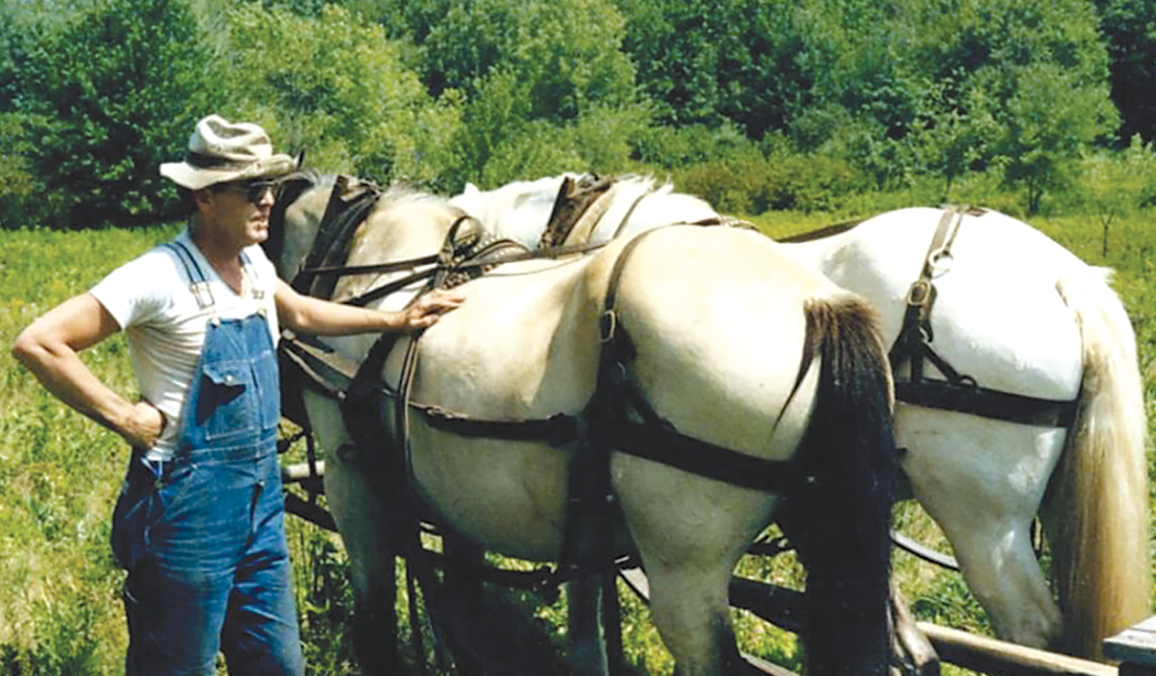 Well known Town official Justin Donnelly is pictured on his Russell Avenue farm. Suffield likes to be known as A Town of Farms, and the late Justin Donnelly, who wore many hats – and helmets – in his life, was described in his published obituary as having died on his farm. Justin was well known and respected in town as a lawyer and dedicated Town official.