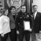 The new badge is a bit awry, but the smile is even and confident as new Suffield officer Alex Scata poses with his family after the department's pinning ceremony. With him are, left and right: his sister Victoria, his mother Wendi, and his father Robert.