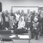 Members of Suffield's Polish Heritage Society assemble for a group portrait after some joyful Polish carol singing at the group's December meeting.