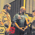 Troop 66's new Eagle Scout Ben Bazzanno gives a Mentor Pin to former troop leader Jim Works. He gave another to Scoutmaster John Riley, left, crediting both with having been great help in his advancement though the Scout program.