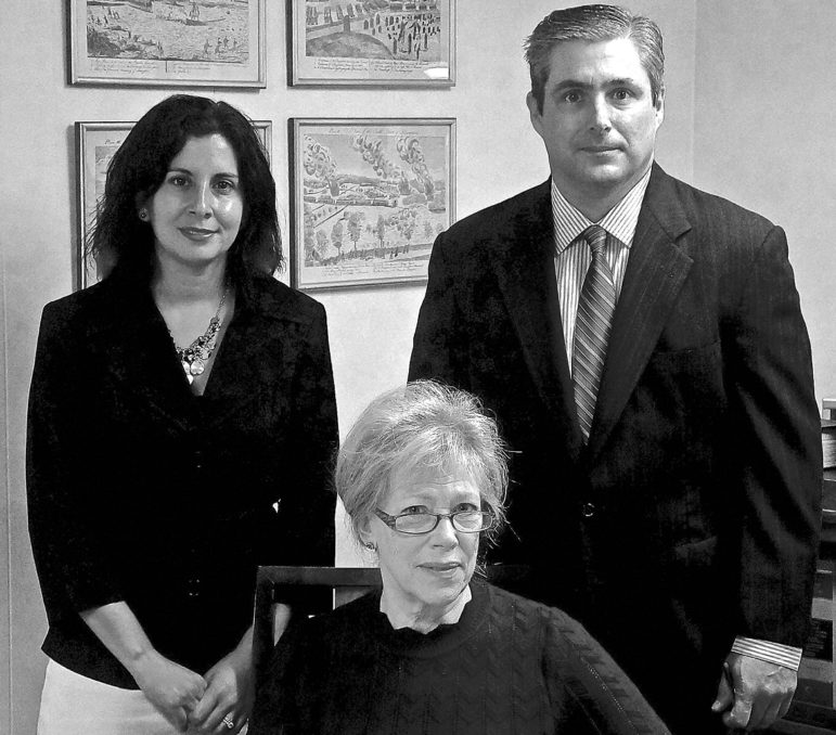 In this portrait of a newly-expanded partnership are, clockwise from the center: Vicky Spellman, Elizabeth Fanous, and David Kelly.