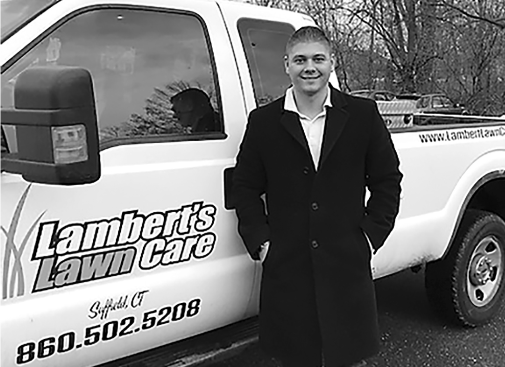 Joe Lambert, proprietor of Lambert's Lawn Care in Suffield, is pictured next to his personal truck.