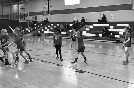 Blocking technique in full form! Girls grades 3 and 4 are having fun in the Parks and Recreation Basketball program.